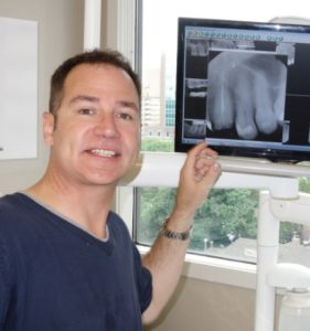 Rob Campbell, with teeth xrays at Archer Dental Rosedale dental clinic